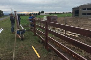 Installing Post and rail PVC fencing